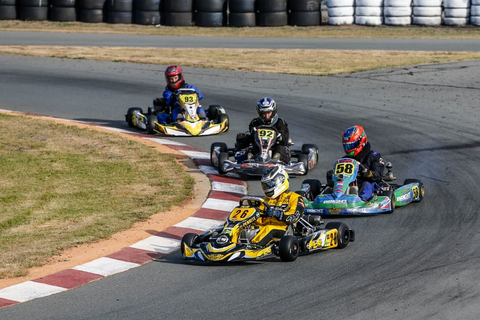 four people racing in a go kart