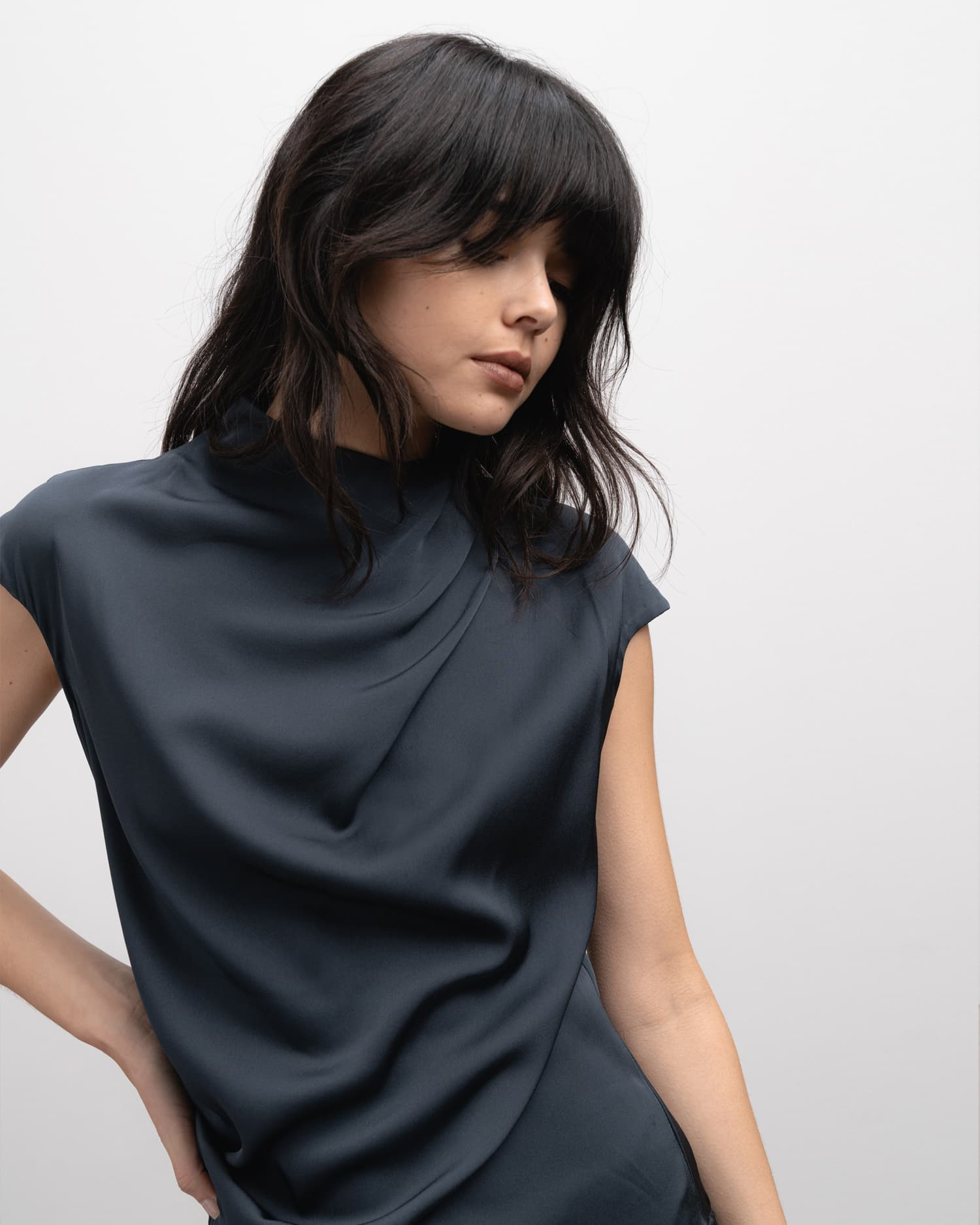 Model wearing Lima top blue grey from the side