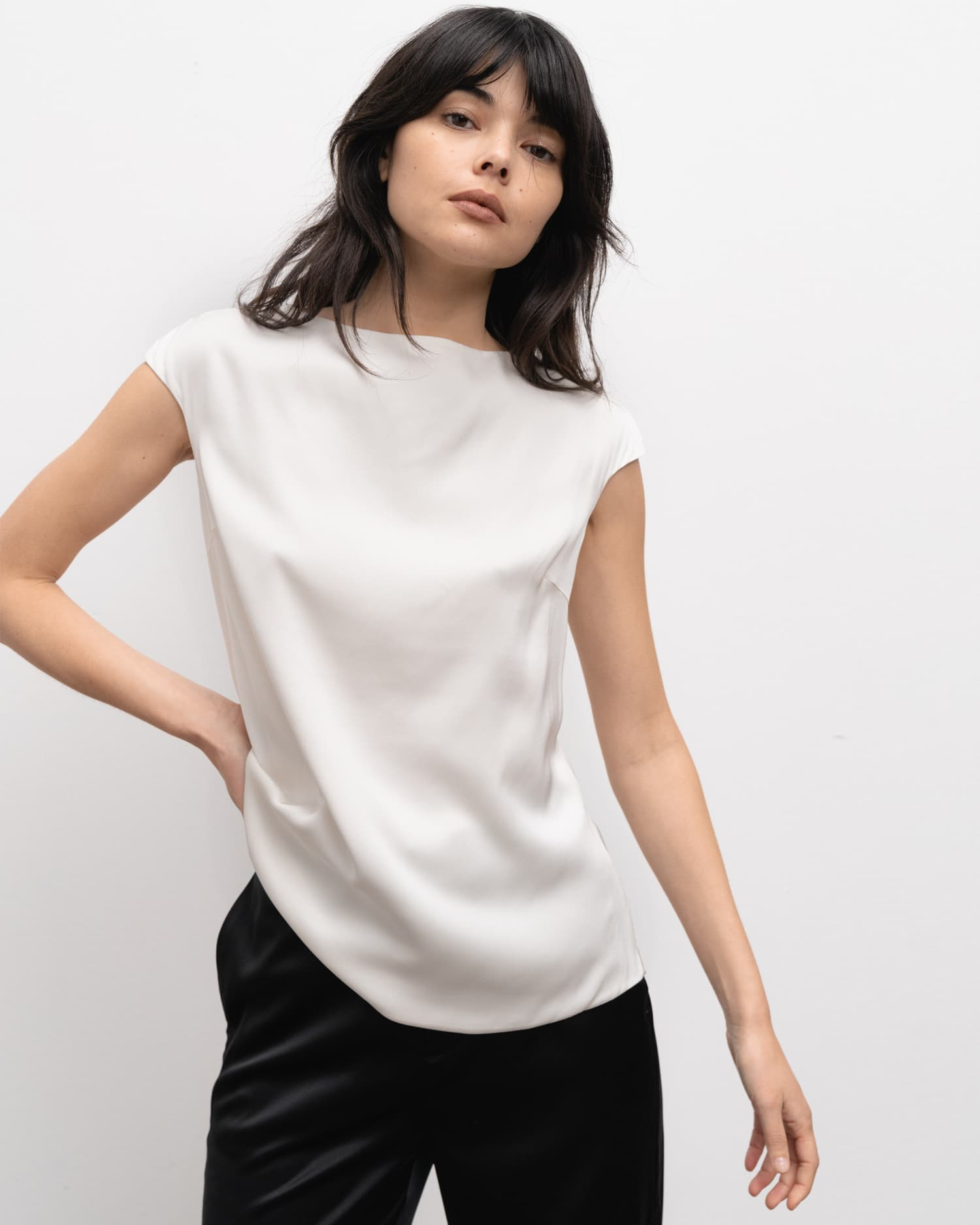 Model wears Yui top off-white from the side