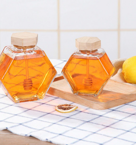 Hexagon honey jar with wooden stirrer