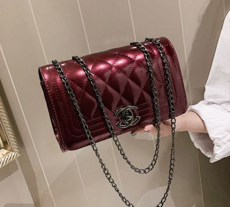 Quilted patent shoulder bag