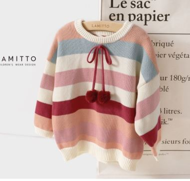 Striped sweater with pom poms