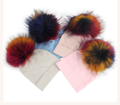 Colored pom pom beanie