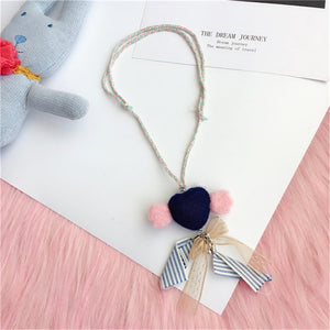 Heart and bow necklace