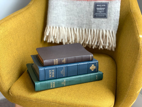 Holy Bibles on a yellow armchair