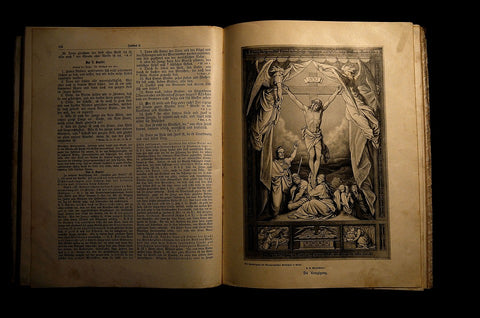 New Testament pages with The Crucifixion of Christ illustration