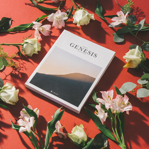 The book of Genesis surrounded by flowers