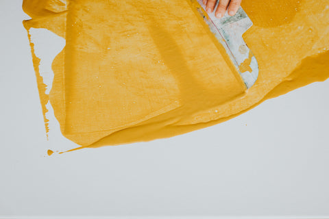 Yellow paint on a canvas