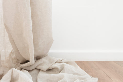 Beige fabric draped on a wooden floor