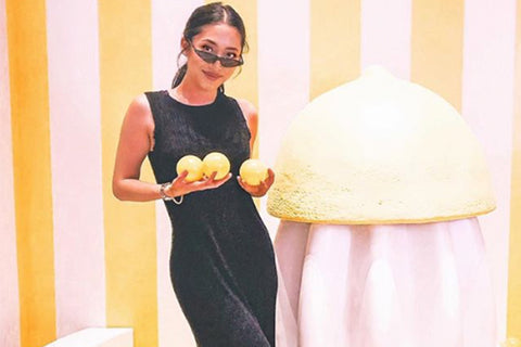 Image of Clair Zhan holding lemons