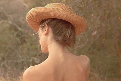 Image of Nina wearing a straw hat