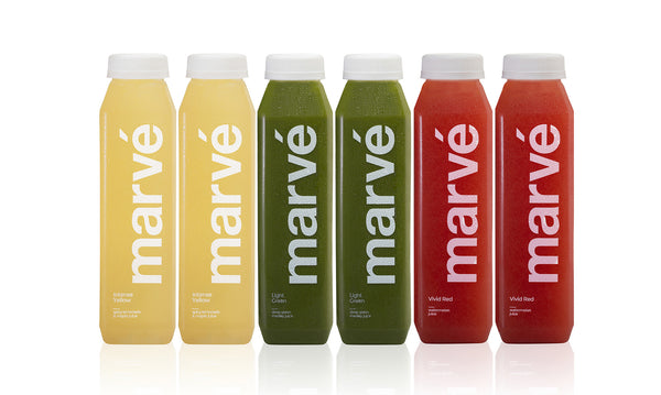 Marve Morning After box cold pressed juice cleanse. Intense Yellow Lemonade. Vivid Red watermelon juice. Light Green Juice.