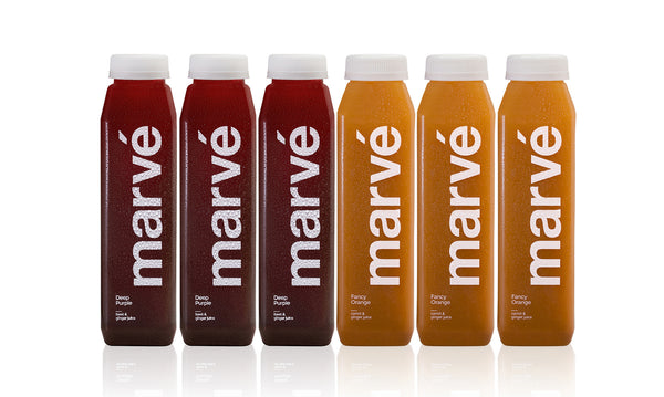 Marve Deep Root cold pressed juice cleanse. Carrot ginger juice. Beet Juice. Detox