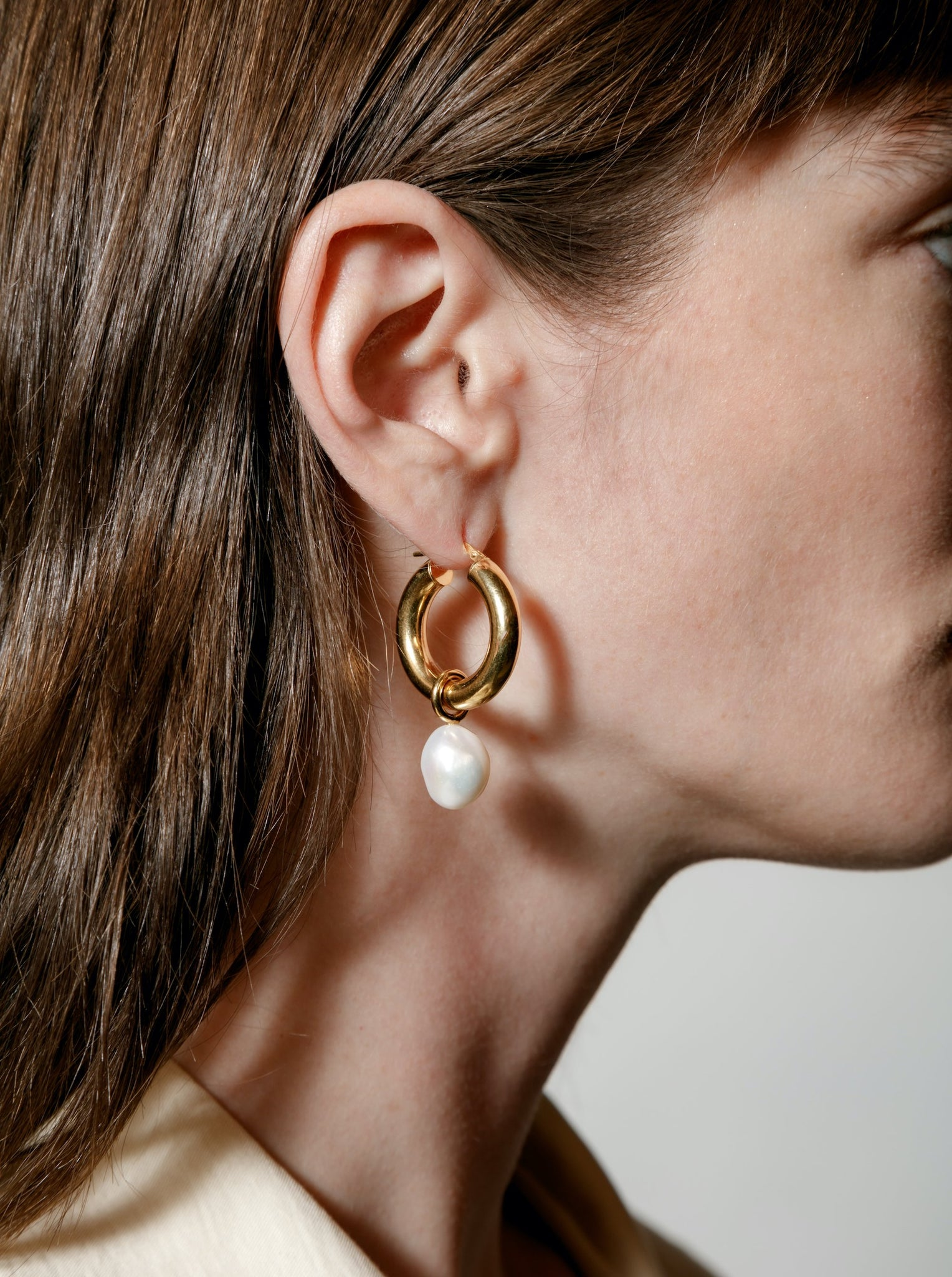 large pearl hoops in gold.
