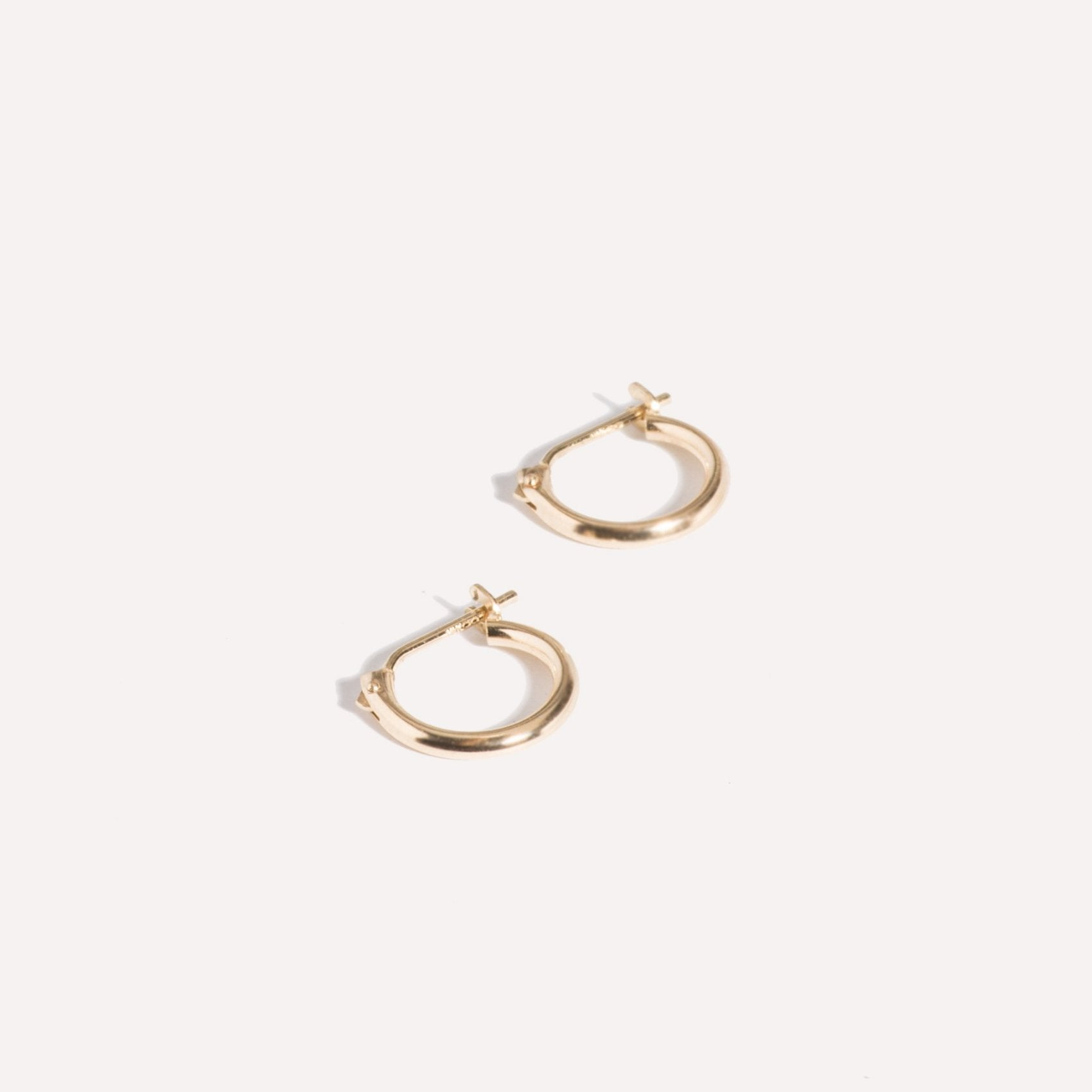 mini hoops in gold.