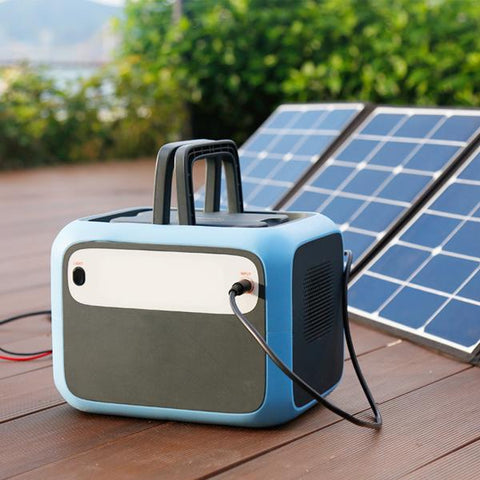 Bluetti - AC50S 500Wh/300W Portable Power Station charged in a solar panel.