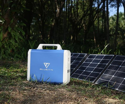 Photo of Bluetti - EB150 1500Wh/1000W Portable Power Station in front of the solar panels.