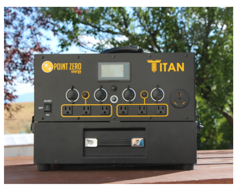 Picture of the Titan Solar Generator with one battery on a table outdoor.