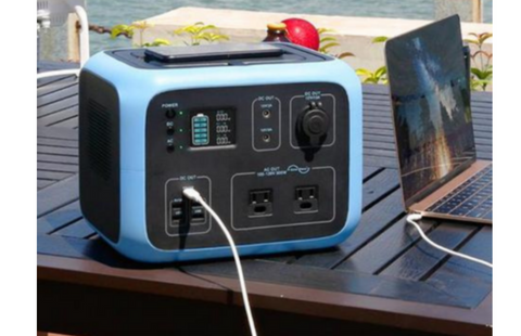 Photo of Bluetti - AC50S 500Wh/300W Portable Power Station hooked in a laptop.