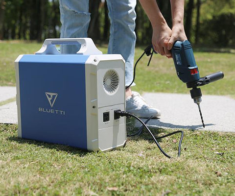 Photo of Bluetti - EB240 2400Wh/1000W Portable Power Station hooked in a power drill.
