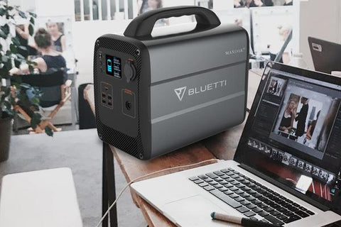 Photo of Bluetti - AC100 1000Wh/600W Portable Power Station beside a laptop