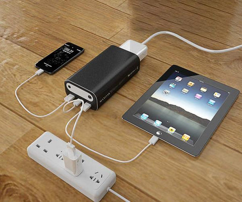 Photo of Bluetti - AC10 99Wh/26756mAh Portable Power Station hooked in a tablet and a cellphone.