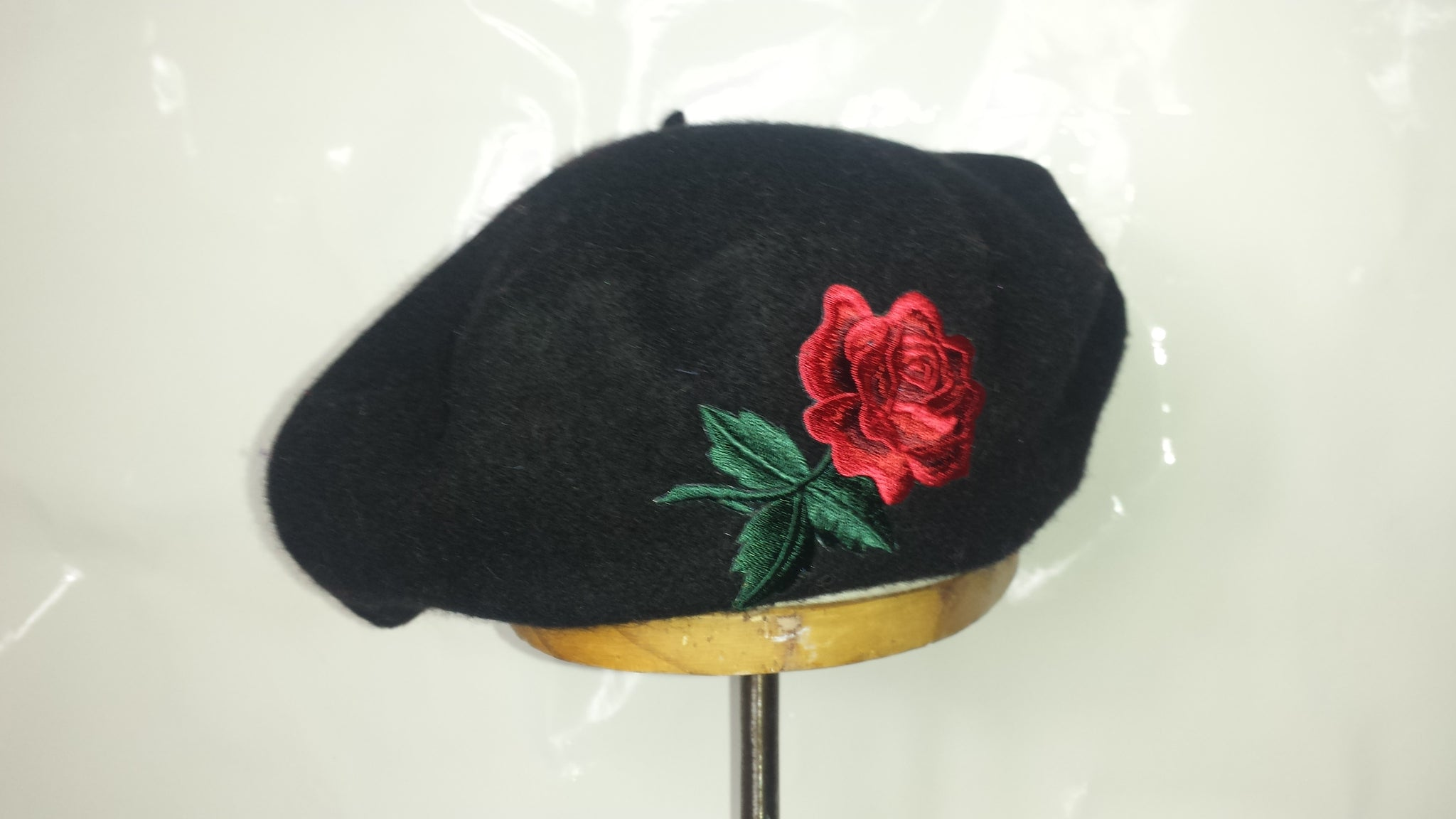red rose black beret rose beret