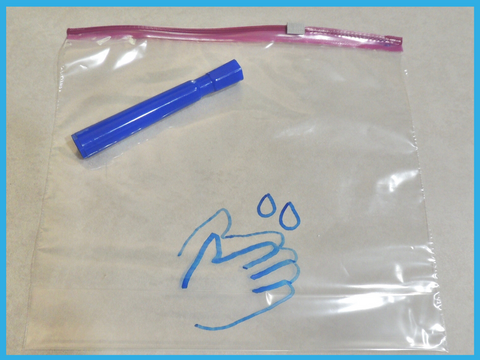 Drawing of hands rubbing together on a zipper bag. Drawn with blue permanent marker.