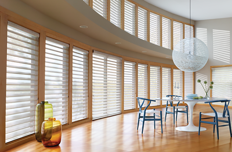 Hunter Douglas Silhouette Window Treatment dining room with wish bone chairs