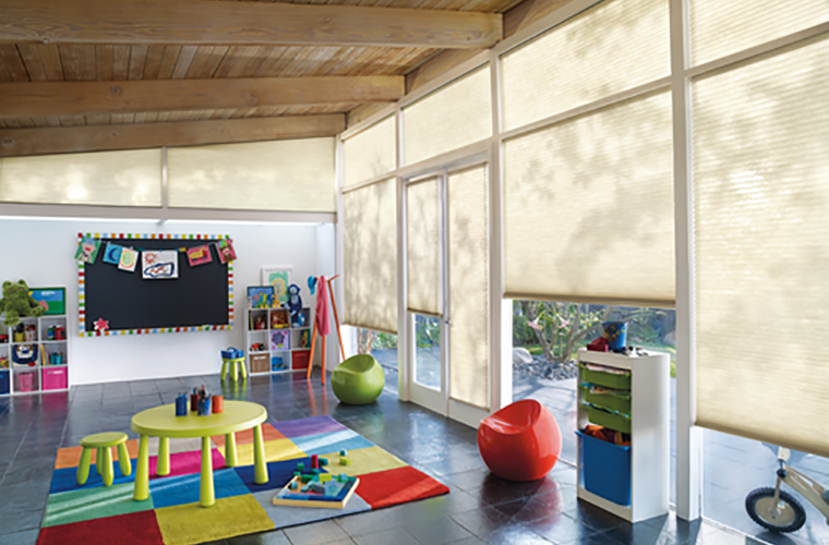 Hunter Douglas Window Treatment Applause kids playroom with lots of toys daycare