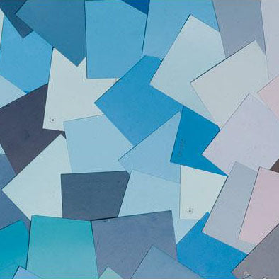 image of multiple blue paint color chips laid out on top of one another