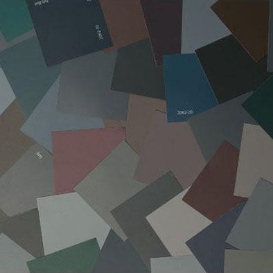 image of multiple bold and dramatic paint color chips laid out on top of one another