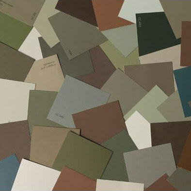 image of multiple earth inspired paint color chips laid out on top of one another