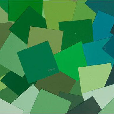 image of multiple green paint color chips laid out on top one another