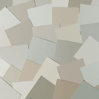 image of multiple neutral paint color chips laid out on top of one another