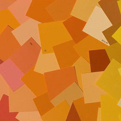 image of multiple organe paint color chips laid out on top of one another