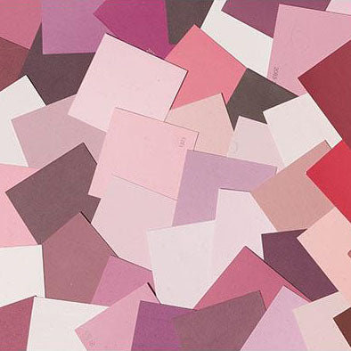 image of multiple pink paint color chips laid out on top of one another