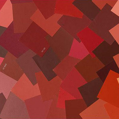 image of multiple red paint color chips laid out on top of one another