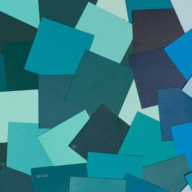 image of multiple teal paint color chips laid out on top of one another