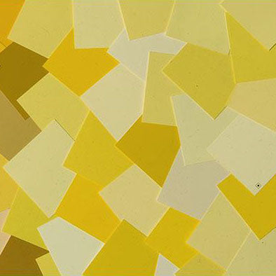 image of multiple yellow paint color chips laid out on top of one another