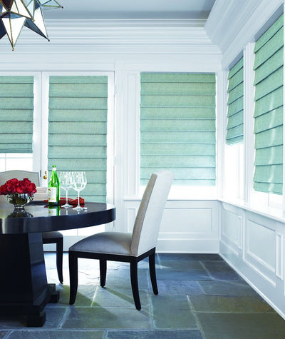 Hunter Douglas Roman Shade Window Treatment from the Design Studio collection in a Sudbury Dining Room