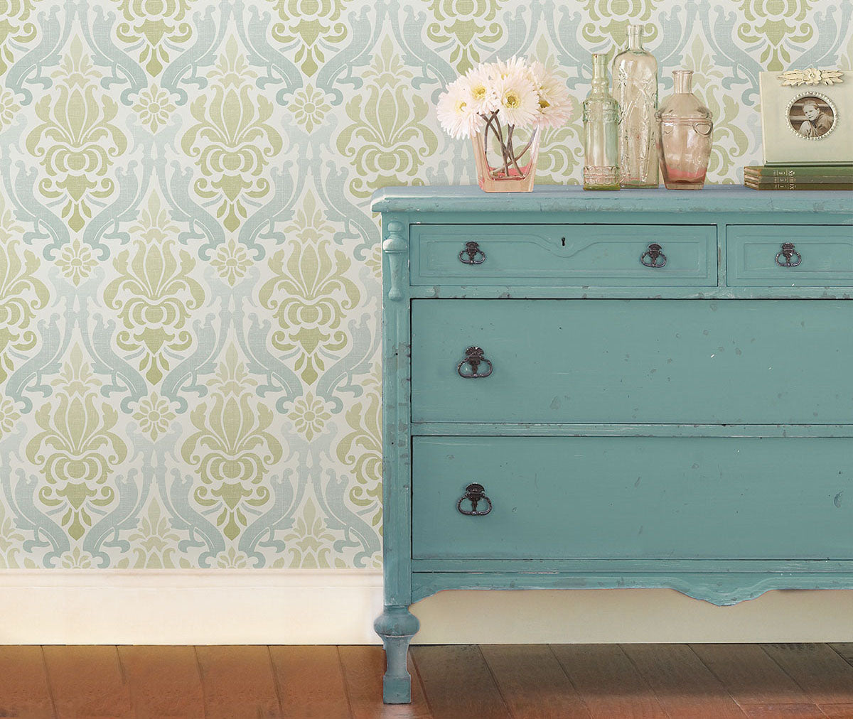 Varying array of blue and green ombre shading damask style wallpaper from Barrydowne Paint.