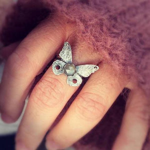 Silver Butterfly Ring with Grey Moonstone photographed on hand