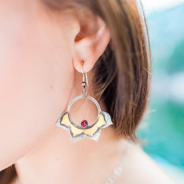 Lotus Hoop Earrings with Garnet photographed on a model side view