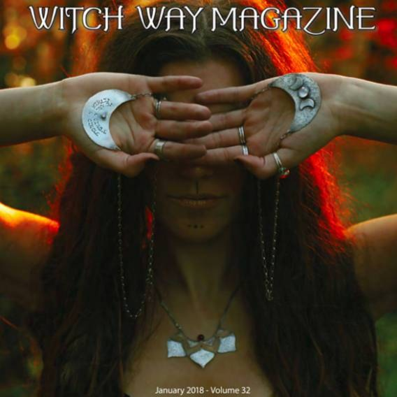 Lotus Statement Necklace with Garnet sterling silver and brass photographed on a model and published cover photo of Witch Way Magazine Winter 2018 issue