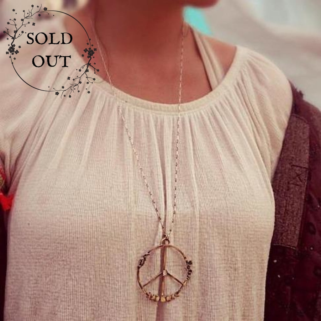 Moon Phases Peace Necklace with Moonstone  worn by a festival goer