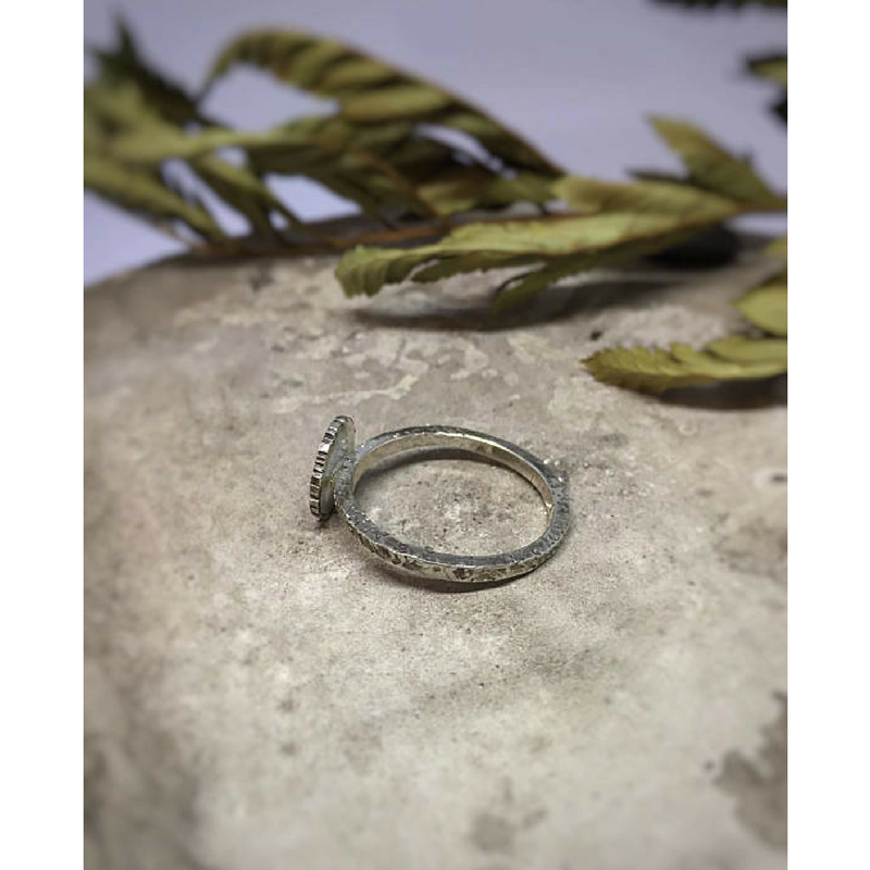 Moon and Star Celestial Ring side view photographed on a stone with dried leaves at the background