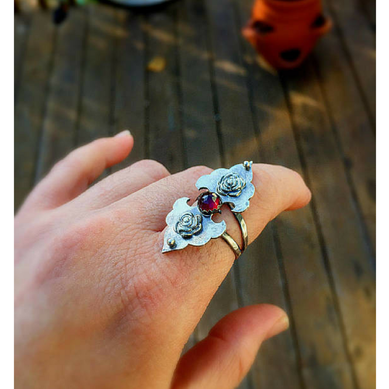 Rosebuds Flower Statement Ring with Garnet top view photographed on a finger