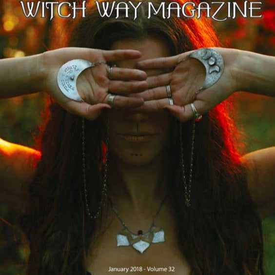 Triple Moon Goddess Necklace with Moonstone photographed on a model who is holding two of these necklaces in her palm above her eyes published on the cover of Witch Way Magazine Winter 2018 issue