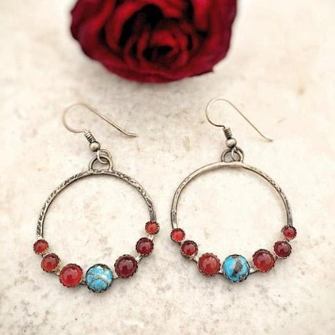 Turquoise Carnelian Gypsy Hoop Earrings laid flat view from top with a red rose behind it